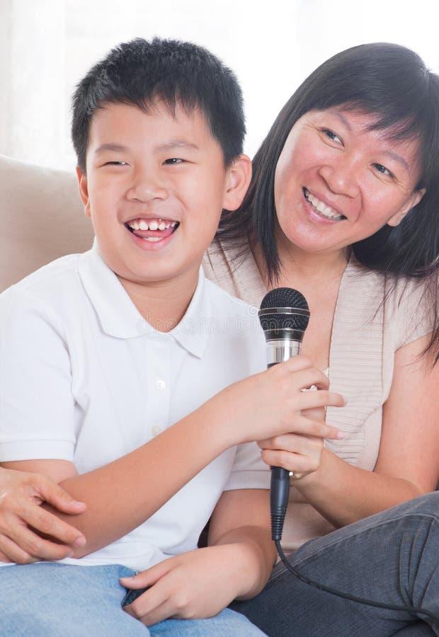 Asian family singing karaoke royalty free stock photography