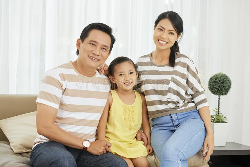 Asian family sitting at home royalty free stock image