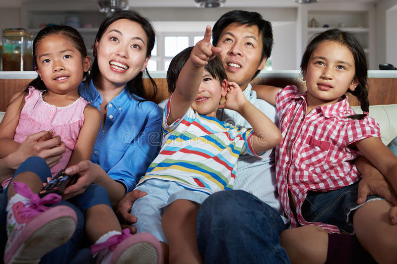 Download Asian Family Sitting On Sofa Watching TV Together Stock Image - Image: 37639989