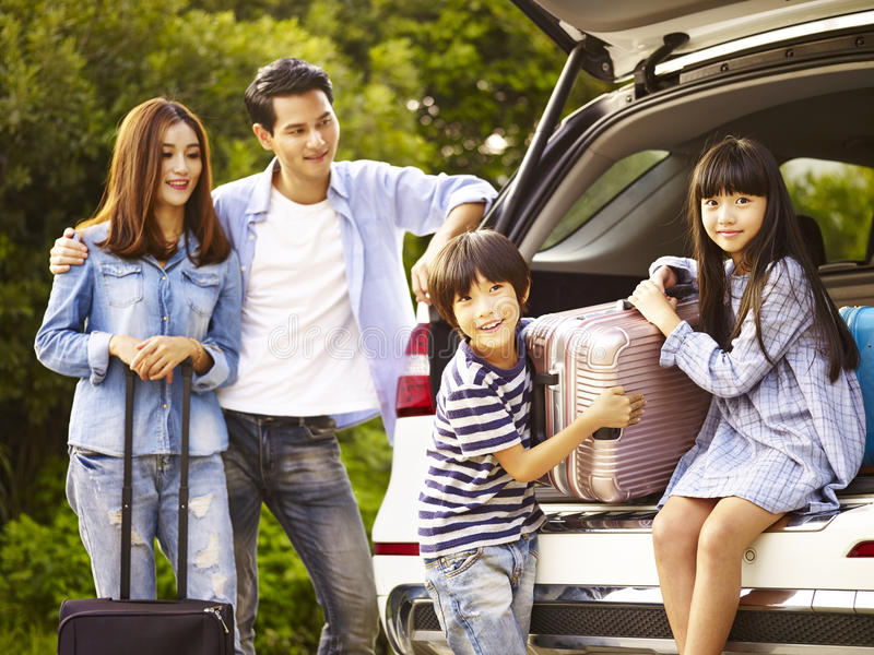 Asian family traveling by car stock photos