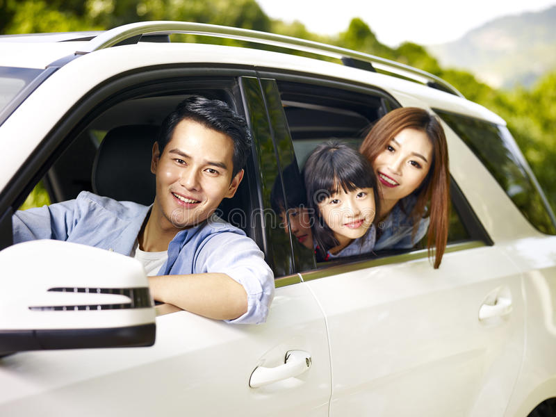 Asian family traveling by car royalty free stock photography