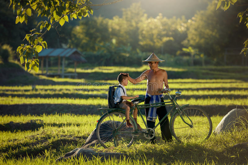Asian Farmer family father and son royalty free stock photography