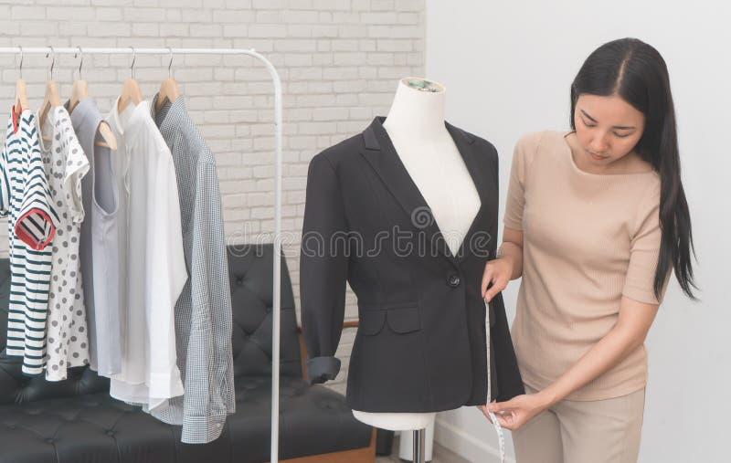 Asian fashion stylist designer measuring jacket stock photos