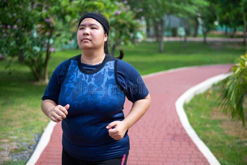 Asian fat woman running royalty free stock images