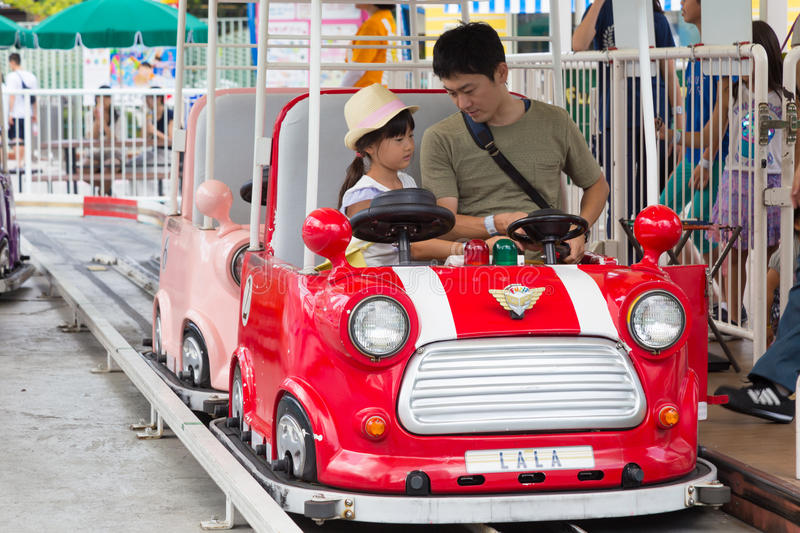 Asian Father and daughter at Tokyo Dome Theme Park stock photo