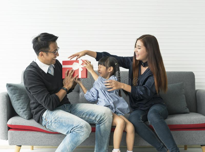 Asian father and mother give present for daughter. concept surprise gift box for birthday stock photos
