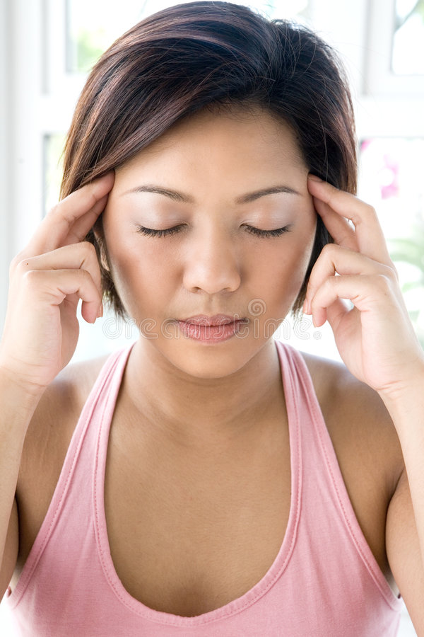 Free Asian Female Applying Gentle Pressure On Temple Stock Photo - 4633720