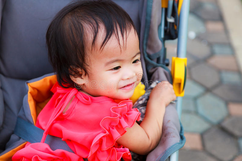 Asian female baby smile in perambulator royalty free stock photo