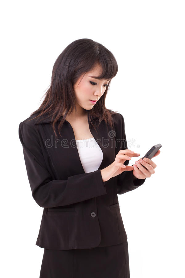 Asian female business woman executive texting, messaging. Using smartphone application royalty free stock photography