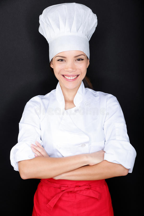 Asian female chef in chef whites uniform and hat royalty free stock image