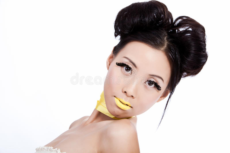 Asian female with creative colorful makeup stock photo