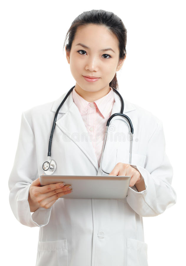 Asian female doctor with digital tablet. Isolated on white stock image