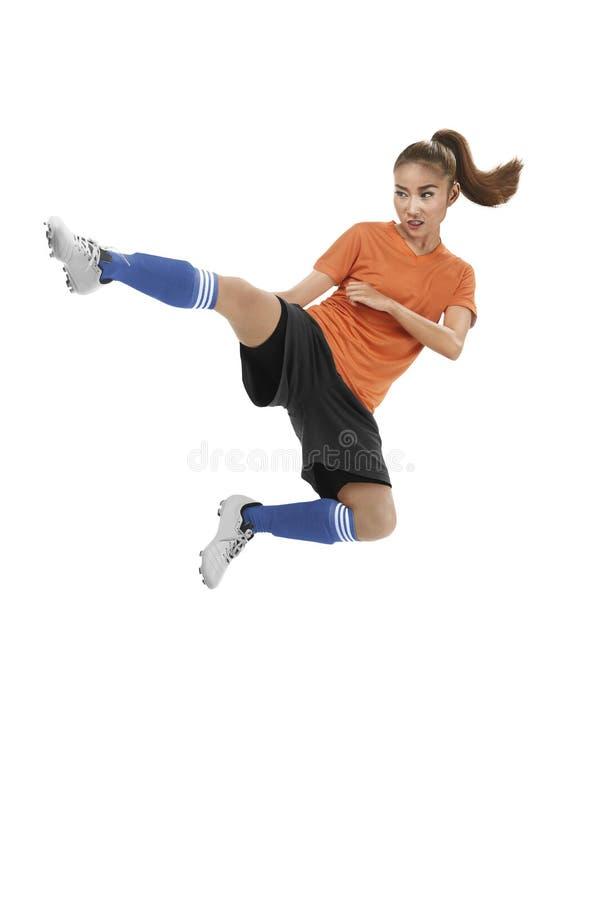 Asian female football player kick ball royalty free stock image