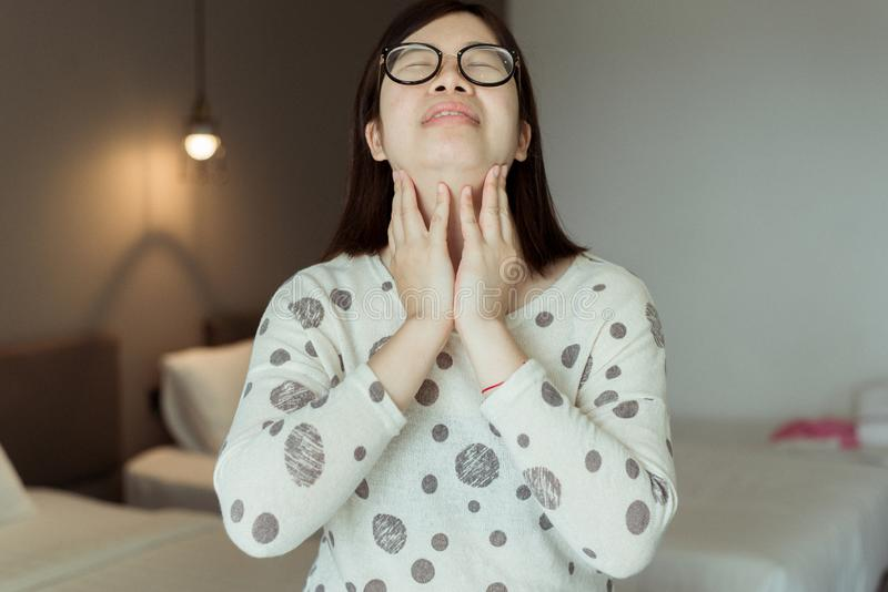 Asian female have a sore throat,Woman touching her neck with hands,Health care Concept. Asian female have a sore throat,Women touching her neck with hands,Health royalty free stock images