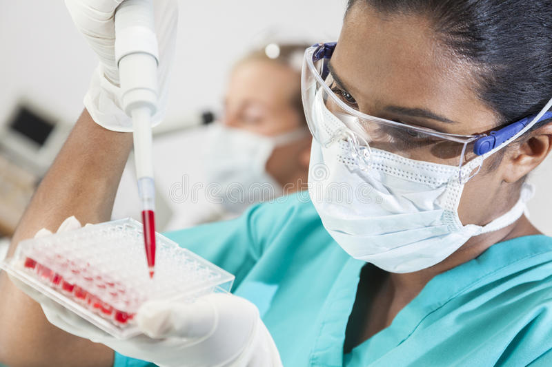 Asian Female Laboratory Scientist Pipette & Blood Sample royalty free stock photos