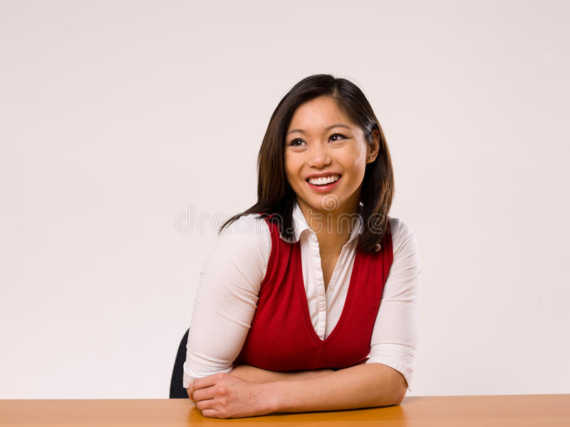 Asian Female Making a facial expression. Asian Female smiling and looking off into the distance stock photo