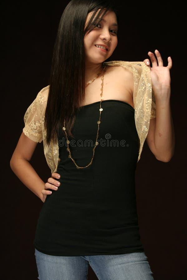 asian female model against a dark background stock photo