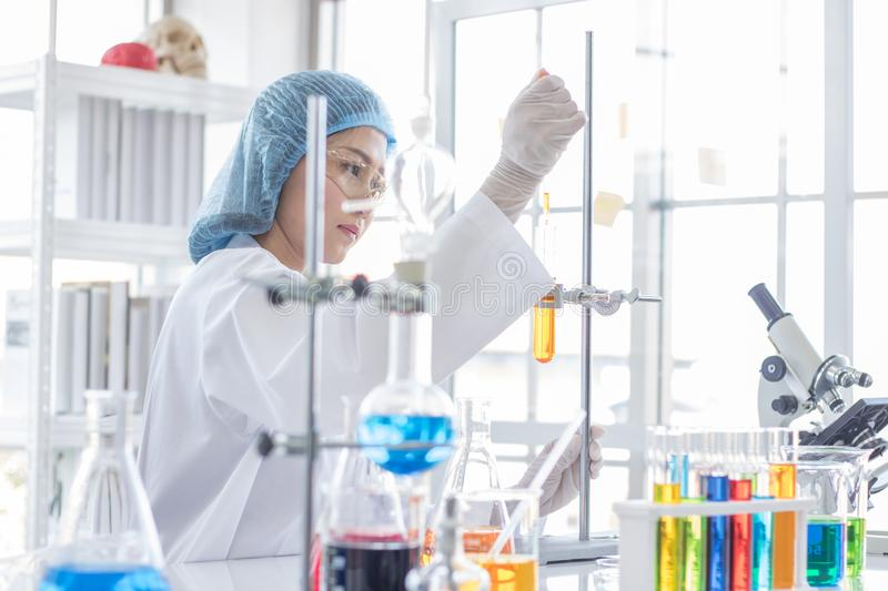 Asian female scientist during study chemicals royalty free stock photography