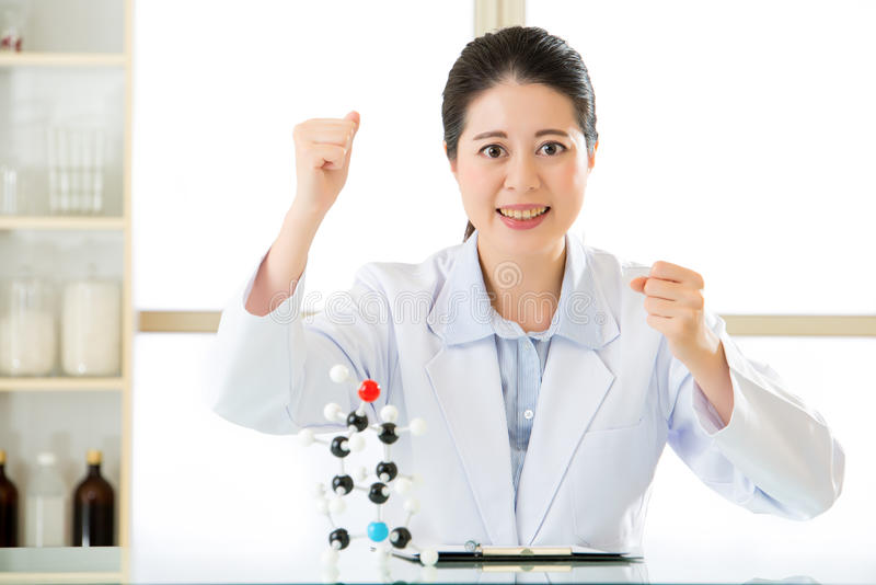 Asian female scientist successful discovery figure out Chemical. Asian female scientist successful discovery Chemical formula on clipboard for science research royalty free stock photo