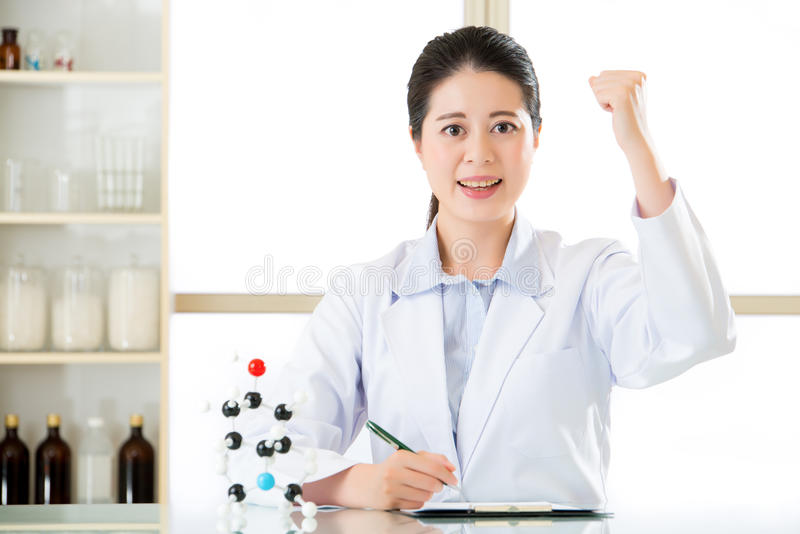 Asian female scientist successful discovery figure out Chemical. Asian female scientist successful discovery Chemical formula on clipboard for science research stock photography