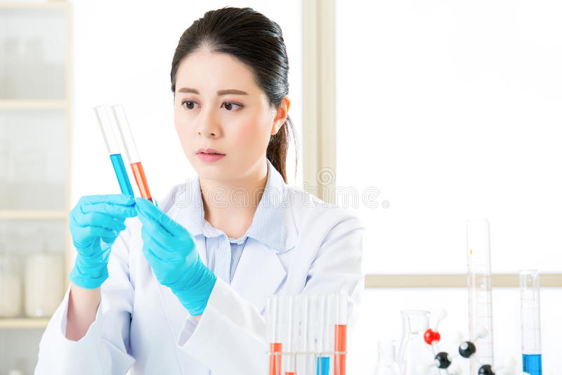 Asian female scientist working on chemical substances in a labor royalty free stock images