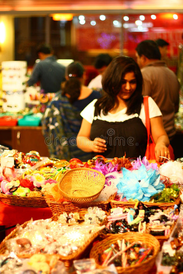 Asian Female Selecting Clothing Accessories royalty free stock image