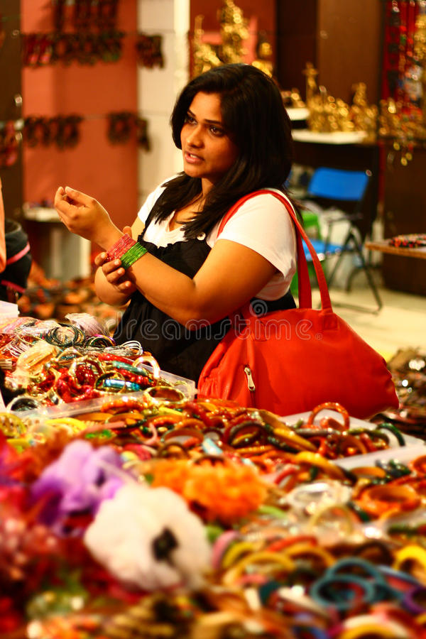 Asian Female Selecting Colorful Bangles royalty free stock images
