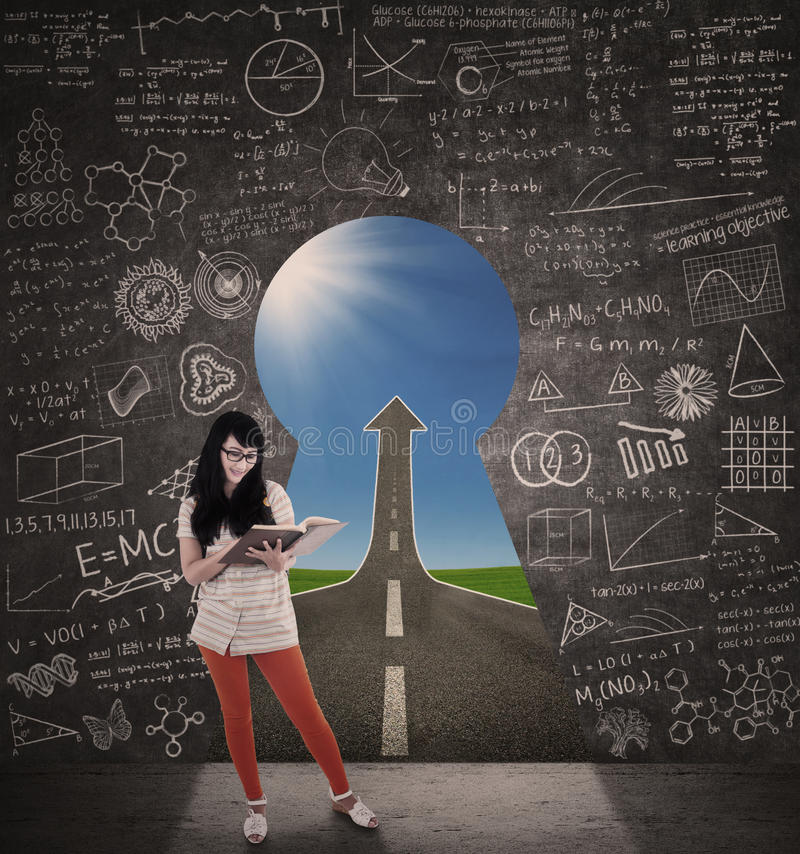 Asian female student reading book with success road stock illustration