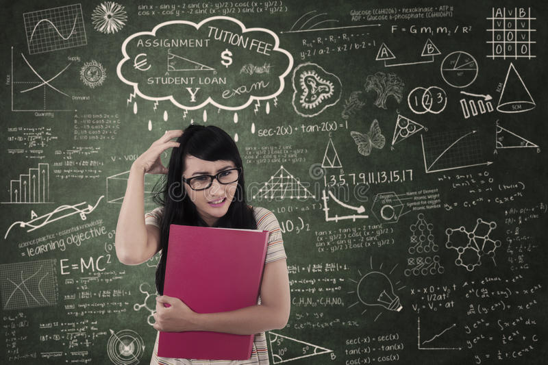 Asian female student upset about assignment in class stock photography