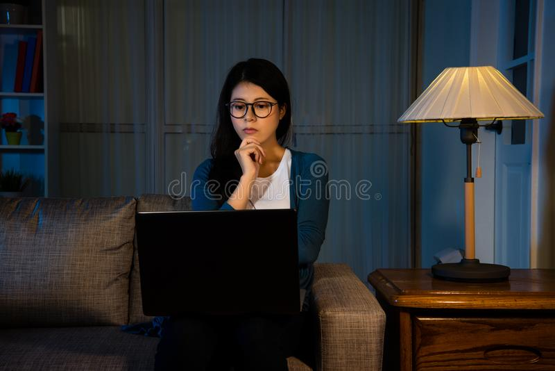 Asian female student watching the latest movie royalty free stock photography