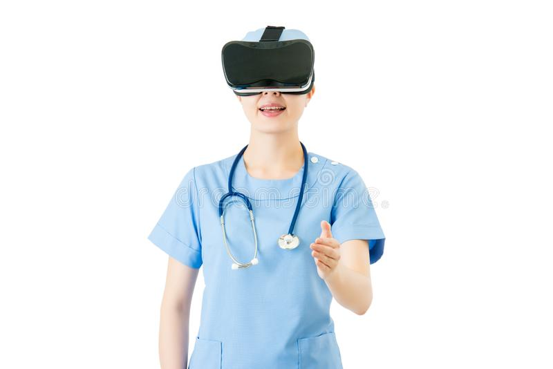 Asian female surgeon handshake by VR headset glasses royalty free stock images