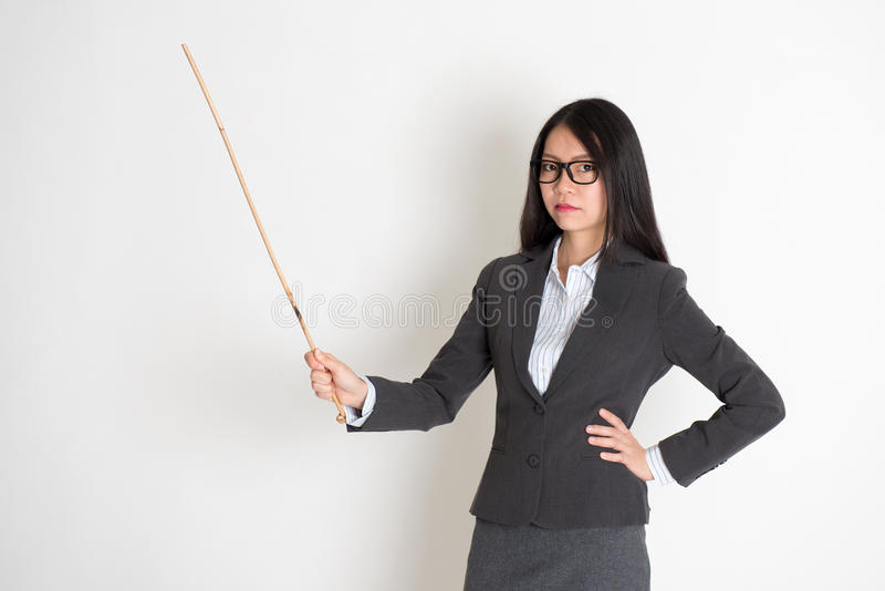 Asian female teacher in serious expression stock photography