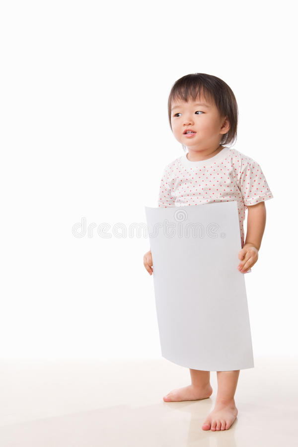 Asian female toddler holding white paper. With lot of copy space in side her royalty free stock images