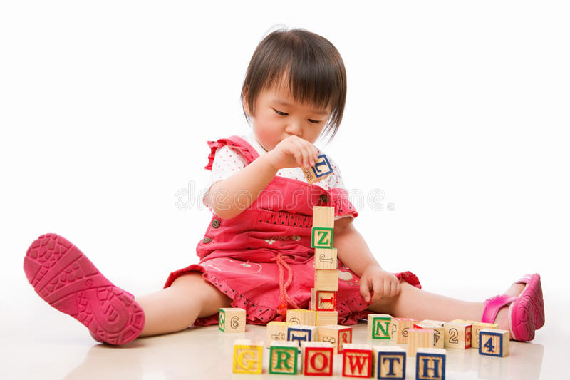 Asian female toddler playing. On the floor alone stock photo