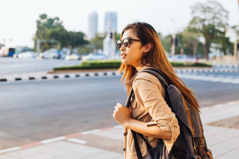 Asian female tourist backpacker walking on street during trip to Bangkok, Thailand stock images