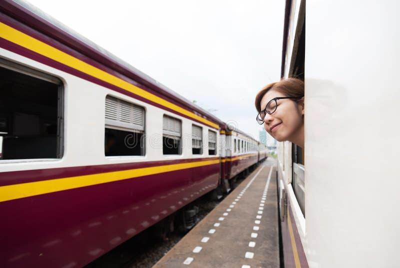Asian female traveler breathing fresh air. royalty free stock image