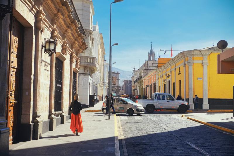 An asian female walks in downtown of Arequipa area, and the weather is very nice. stock photos