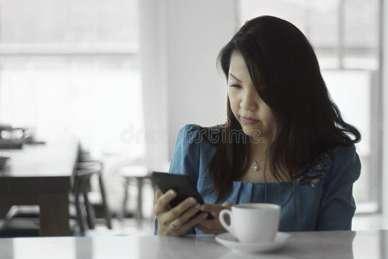 Asian female women portraits look smart phone stock image