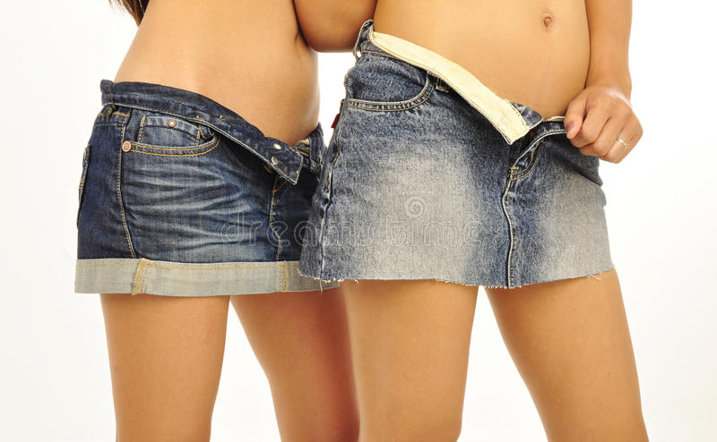 Asian females wearing unbuttoned mini denim skirts royalty free stock photo
