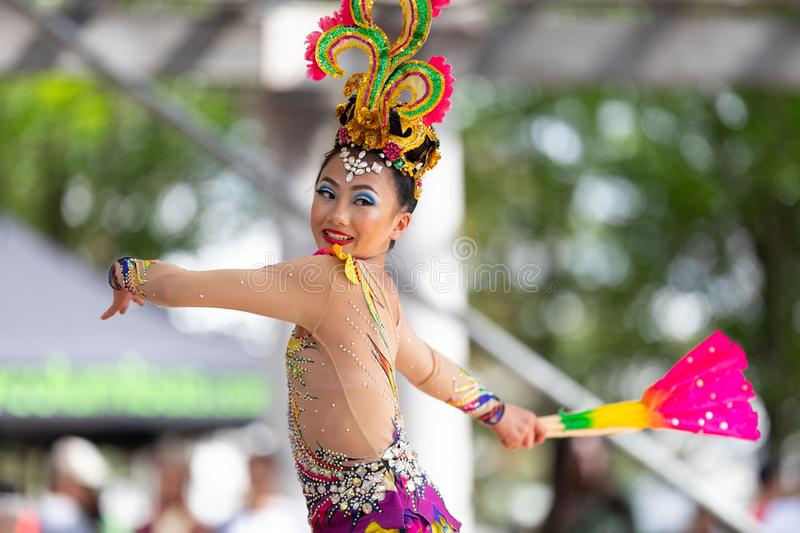 Asian Festival. Columbus, Ohio, USA - May 26, 2019: Columbus Asian Festival, Young girls performing Hmong traditional dances, in the amphitheater at Franklin royalty free stock images