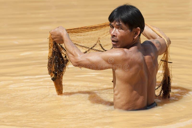 Asian fisherman with throw net stock photos