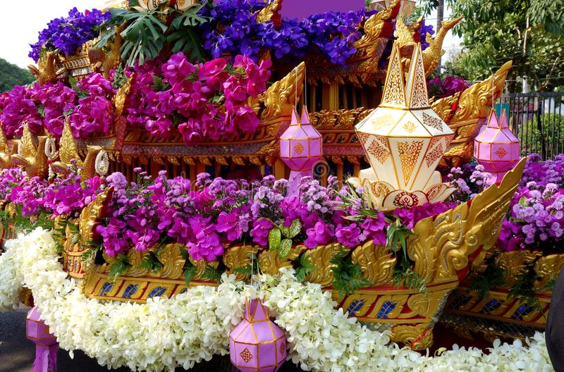 Asian Flower Festival Parade Float. A closeup colorful image of a thai Parade Float covered in purple blue and white flowers and asian lanterns from the Flower royalty free stock photos