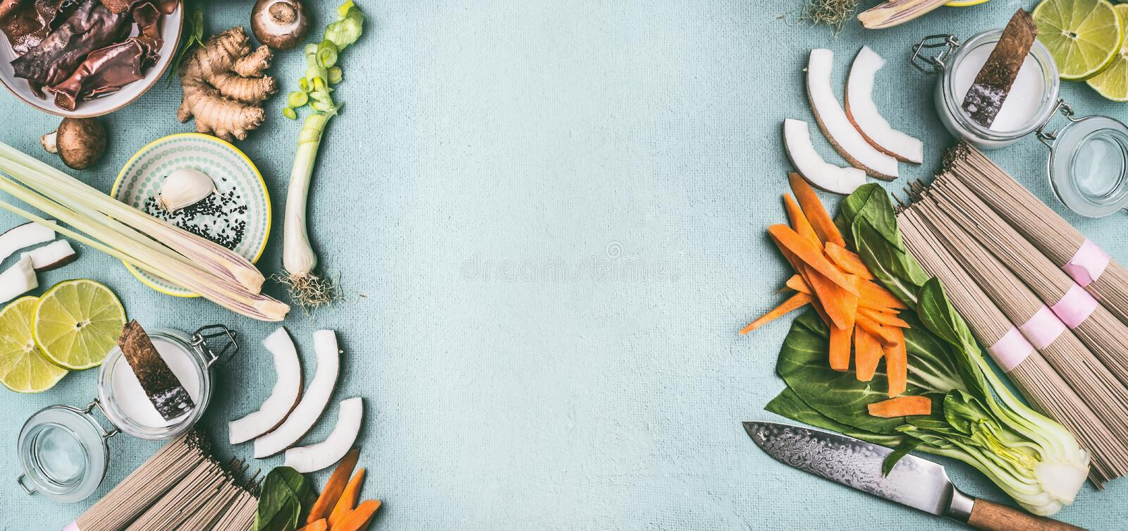 Asian food background frame with various traditional cooking ingredients: noodles, vegetables and spices, top view, flat lay. stock photos