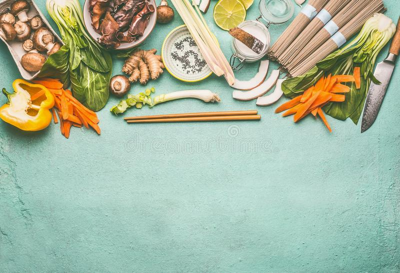 Asian food background with tasty ingredients: Mu Err Mushrooms , various vegetables , pok choi , coconut milk, lemongrass. And noodles , top view, copy space stock photo