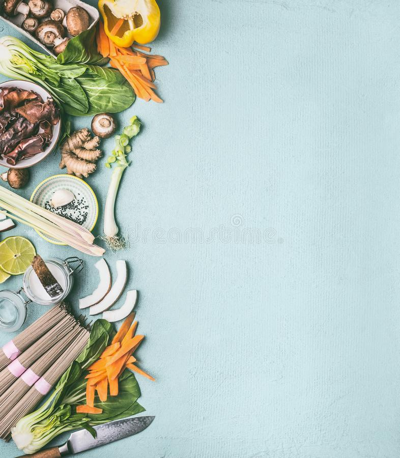 Asian food background. Various traditional ingredients for vegetarian cooking: noodles, vegetables, mushrooms and spices, top view royalty free stock photography