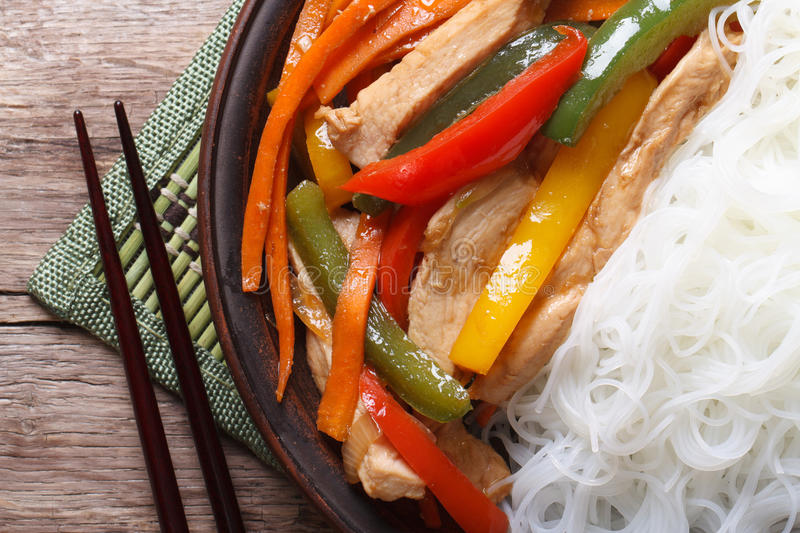 Asian food chicken with rice noodles macro horizontal top view royalty free stock photo