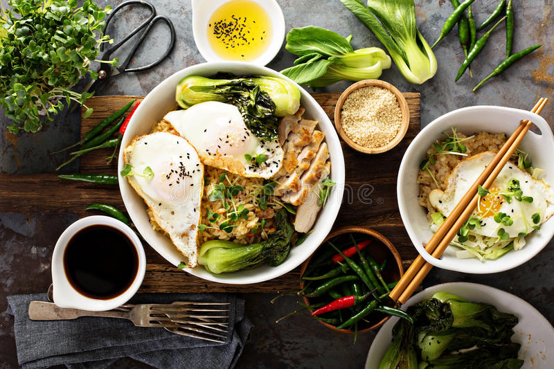 Asian food concept with fried rice, baby bok choy. Eggs and soy sauce stock images