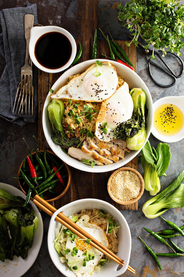 Asian food concept with fried rice, baby bok choy stock photography