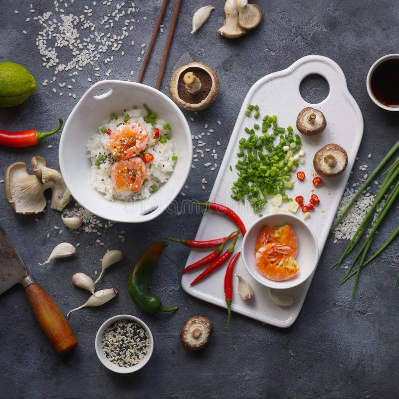 Asian food on a dark background, Wok rice with shrimps and mushrooms, During preparation royalty free stock photos