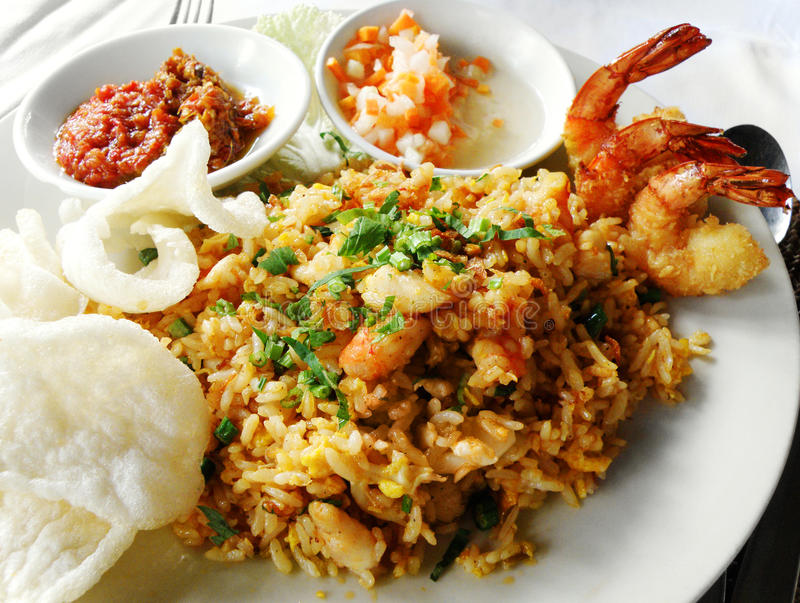 Asian food, fried rice with seafood. A colour photograph of Seafood Nasi goreng, a dish of ethnic asian cuisine of stir fried rice with assorted seafoods royalty free stock photography